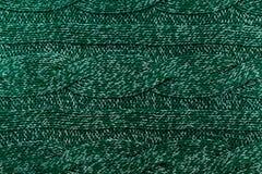 Fondo tricottato di verde del jersey con un modello in rilievo. Alto reso Fotografie Stock