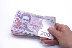 Fondo ucraino dei soldi fatto di duecento note di hryvnia Fotografia Stock Libera da Diritti