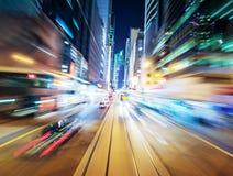 Fondo urbano astratto della città di notte vago tramite moto fotografie stock libere da diritti
