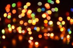 Fondo vago, bokeh con le luci variopinte, illuminazione di festa fotografie stock libere da diritti