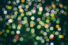 Fondo variopinto di Natale dalle luci variopinte come modello fotografia stock
