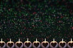 Fondo variopinto romantico di Natale con le candele fotografie stock libere da diritti