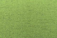 Fondo verde caldo del tessuto irregolare immagini stock