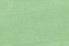 Fondo verde chiaro da una materia tessile con il modello di vimini, primo piano fotografia stock libera da diritti