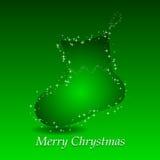 Fondo verde con el calcetín del regalo de la Navidad Foto de archivo libre de regalías