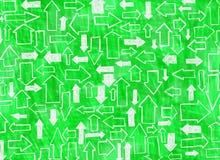 Fondo verde con las flechas Fotos de archivo libres de regalías