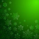 Fondo verde con los copos de nieve, Imagenes de archivo
