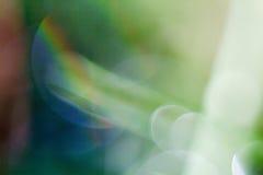 Fondo verde con los puntos brillantes blurry imágenes de archivo libres de regalías