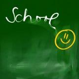 Fondo verde de la pizarra - escuela feliz Foto de archivo libre de regalías