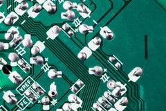 Fondo verde de la placa de circuito de la placa madre del ordenador fotos de archivo