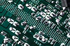 Fondo verde de la placa de circuito de la placa madre del ordenador fotografía de archivo