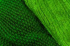 Fondo verde de la textura de las lanas que hace punto Horizonte hecho punto colorido Foto de archivo