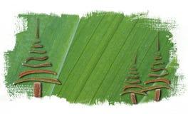 Fondo verde dell'estratto della pittura con gli alberi di Natale Fotografia Stock