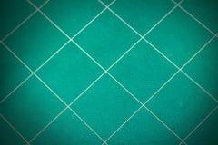 Fondo verde usado de la estera del corte Foto de archivo libre de regalías