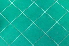 Fondo verde usato della stuoia di taglio Fotografia Stock