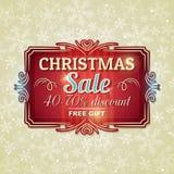 Fondo y etiqueta de la Navidad con oferta de la venta Imagenes de archivo