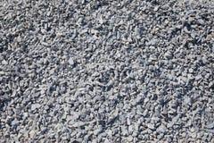 Fondo y textura de los escombros grises del granito fotos de archivo
