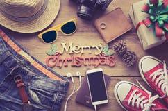 Fondo y trajes de la Navidad para el viaje en la Navidad Foto de archivo