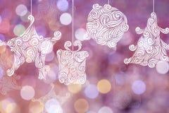 Fondos del día de la Navidad con los fondos rosados del bokeh Imagen de archivo libre de regalías