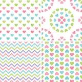 Fondos en colores pastel retros inconsútiles fijados del corazón stock de ilustración