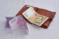 Fonds mit dem Geld getrennt auf weißem Hintergrund Stockfotos