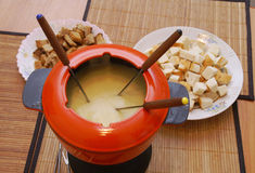The fondue. In the big red pan Stock Photography