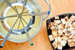 Fondue and croutons Stock Image