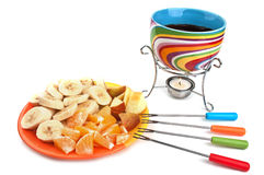 Fondue cup and plate with fruits Stock Images