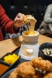 'fondue' de queso con cerdo frito Foto de archivo