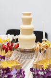 Fondue fountain of white chocolate being dipped Royalty Free Stock Photos