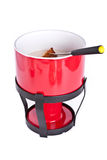 Fondue pot with fork and bread Stock Photos