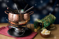 Fondue set. Set for cooking fondue, cheese, wine and white bread royalty free stock photos