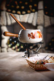 Fondue in a wine cellar. Stock Images