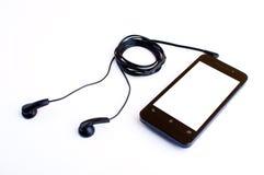 Fone de ouvido e handphone Imagens de Stock