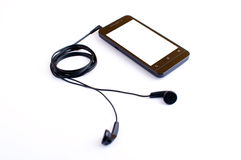 Fone de ouvido e handphone Fotografia de Stock Royalty Free