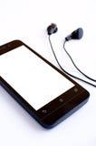 Fone de ouvido e handphone Fotos de Stock