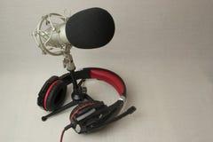 Fones de ouvido do microfone fotografia de stock