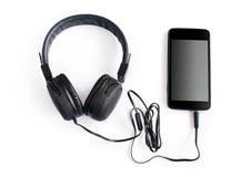 Fones de ouvido e smartphone Foto de Stock Royalty Free