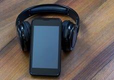 Fones de ouvido e telefone imagens de stock royalty free