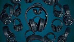 fones de ouvido de giro da ilustração 3D Gray Headphones isolou-se no fundo da cor Fones de ouvido de queda Foto de Stock Royalty Free