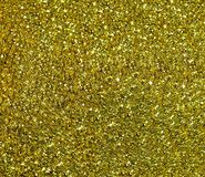 Fonkelende Gouden achtergrond met grote lovertjes Stock Afbeelding