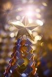 Fonkeling bij de bovenkant van de Kerstboom Stock Foto's