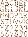 Font. Of the stones on a white background. Latin alphabet royalty free stock photography