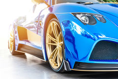 Font of a blue sport luxury car in sunset Stock Image