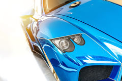 Font of a blue sport luxury car in sunset light Stock Images