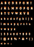 Font of fire. Burning font isolated on black Royalty Free Stock Photo