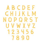 Font gold. Alphabet of placer gold. Font golden sand . Font of gold sparkles. Yellow font Stock Photos