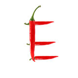 Font made of hot red chili pepper isolated on white - letter E Royalty Free Stock Image