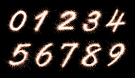 Font. Number 0,1,2,3,4,5,6,7,8,9 made of sparklers font isolated on black background royalty free stock photography