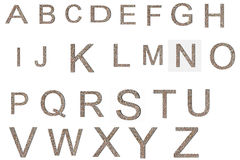 Font from old and weathered stone wall texture alphabet Royalty Free Stock Photo
